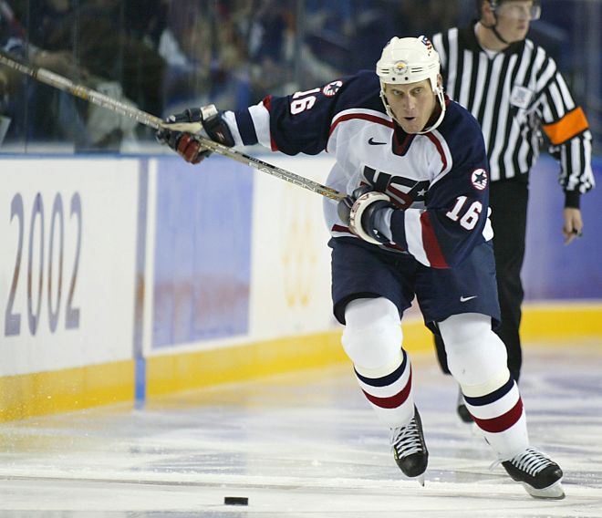 SALT LAKE CITY, UNITED STATES:  Brett Hull of the US pursues the puck during the Men's Ice Hockey quarter-final against Germany in the XIX Winter Olympics 20 February 2002 at the E Center in Salt Lake City, Utah. Brett Hull scored two goals as the US breezed past Germany 5-0, booking a rematch with Russia in the proces  AFP PHOTO/Robert SULLIVAN (Photo credit should read ROBERT SULLIVAN/AFP/Getty Images)
